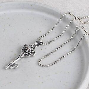 Arabesque Key Skull Pendant Necklace