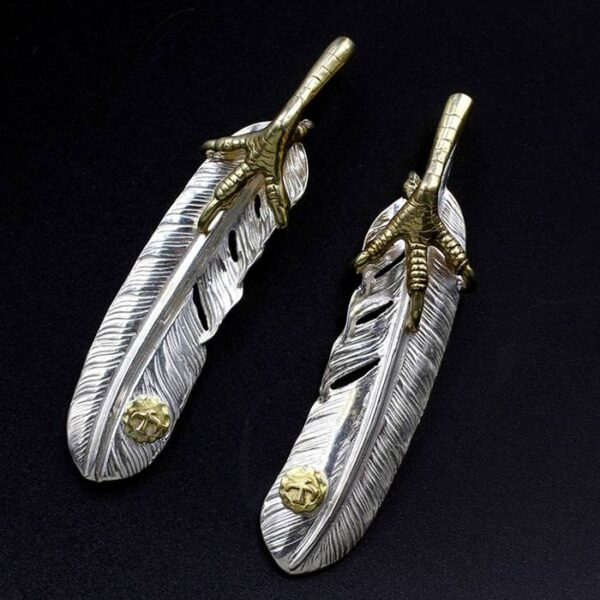 Silver Feather Pendant With Gold Claw